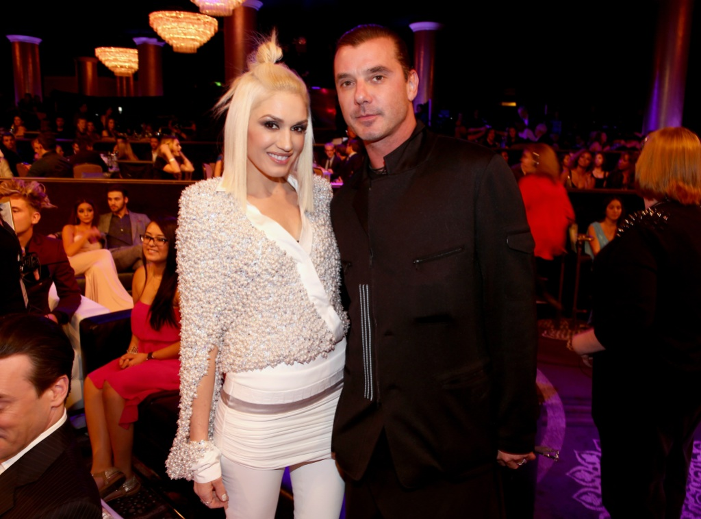 Gwen Stefani Wearing White With Gavin Rossdale in a Black Outfit