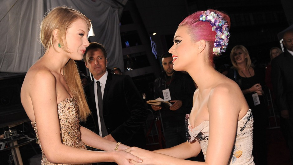 Taylor Swift in a Gold Dress with Katy Perry With Pink Hair Holding Hands