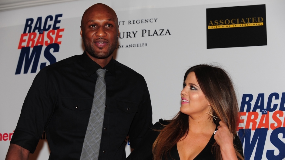 Lamar Odom Wearing a Black Shirt with a Tie and Khloe Kardashian With a Black Outfit