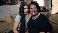 Alice Johnson Wearing a Black Outfit with Kim Kardashian in a Gray Shirt