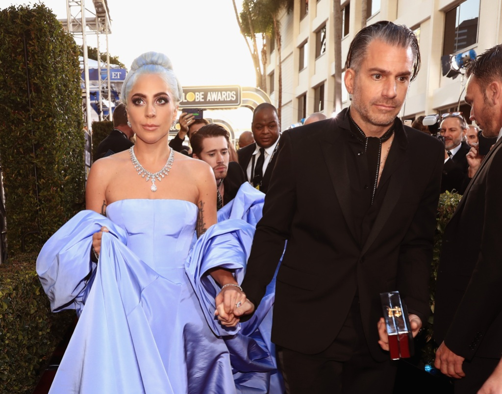Lady Gaga Wearing a Purple Dress with Christian Carino in a Suit