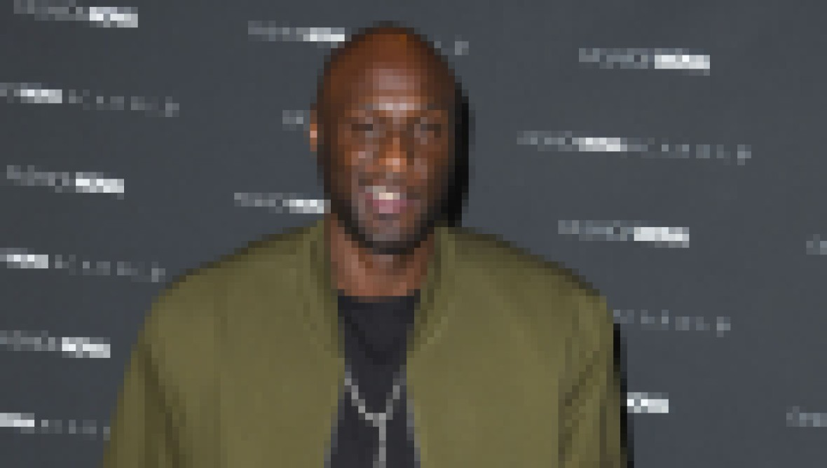 Lamar Odom Wearing a Green Jacket