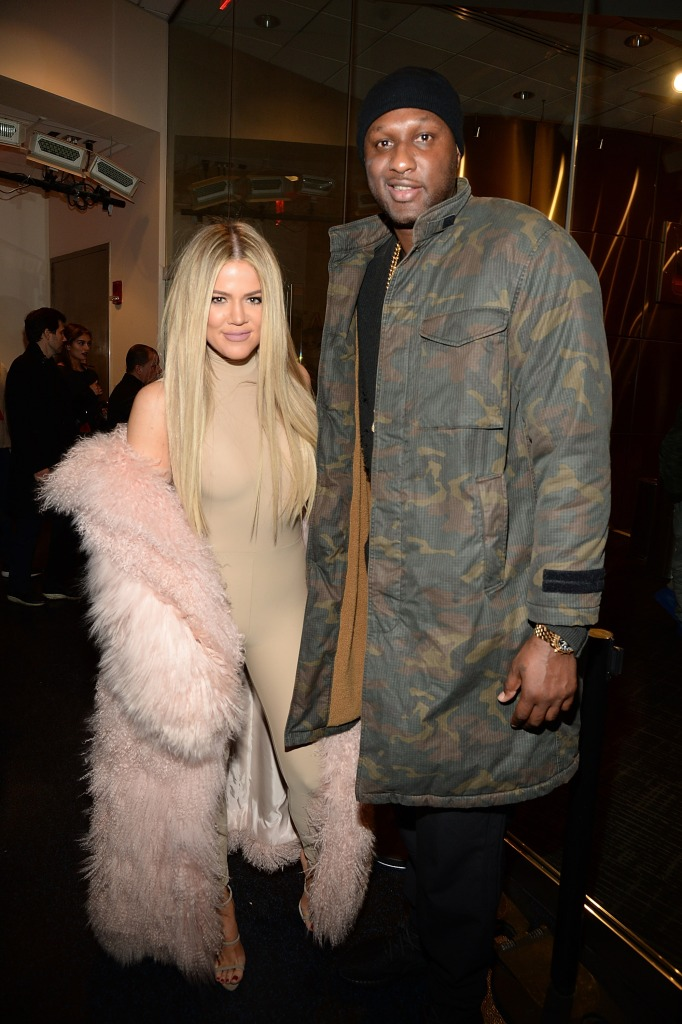 Khloe Kardashian Wearing a Pink Outfit with Lamar Odom in a Army Jacket
