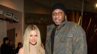 Khloe Kardashian With Blonde Hair and Lamar Odom Wearing a Black Hat and Army Sweatshirt