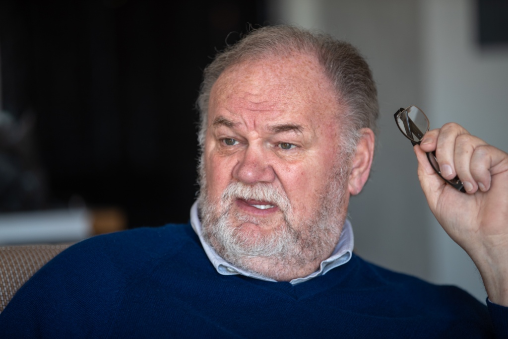 Thomas Markle Wearing a Blue Sweater With His Glasses