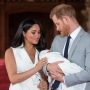 Meghan Markle Wearing a White Dress with Prince Harry in a Suit