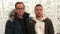 Mike The Situation Wearing a Coat with Vinny in a White Sweatshirt