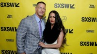 Nikki Bella Wearing a White Background With Ex John Cena in a Suit