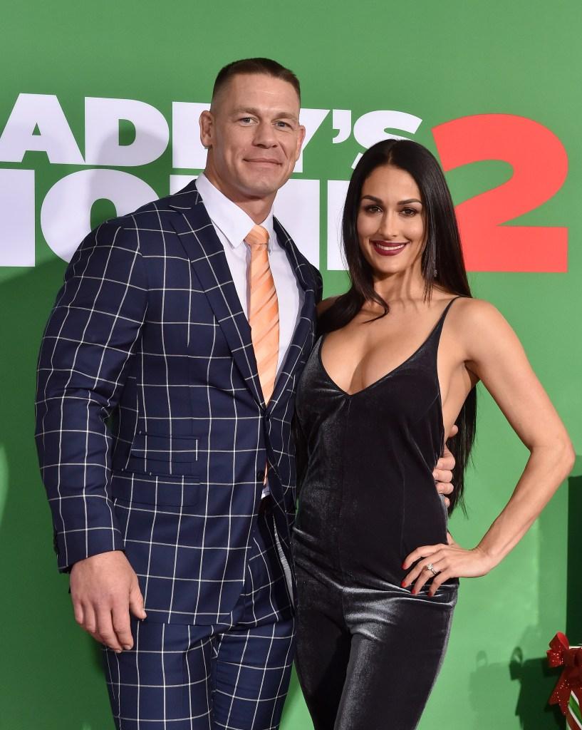 Nikki Bella Wearing a Black Outfit With John Cena