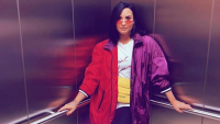 Demi Lovato Wearing a Rainbow Jacket