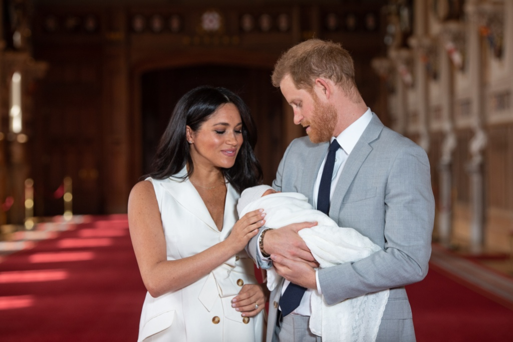Meghan Markle Wearing White With Prince Harry in a Suit