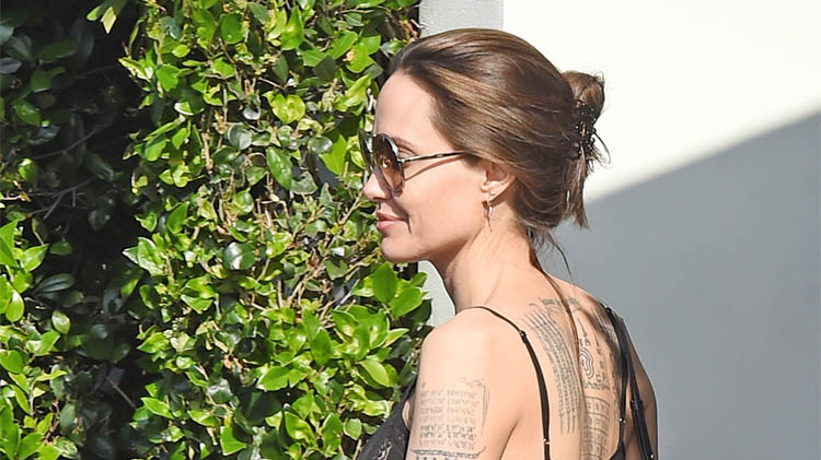 43e19a808 Angelina Jolie Shows Off Back Tattoos in an Edgy, All-Black Look During  Lunch With Pax