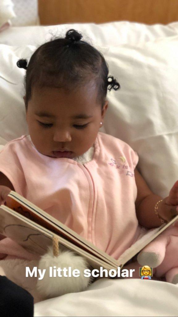 True Thompson reading book pink onesie pjs khloe kardashian tristan thompson