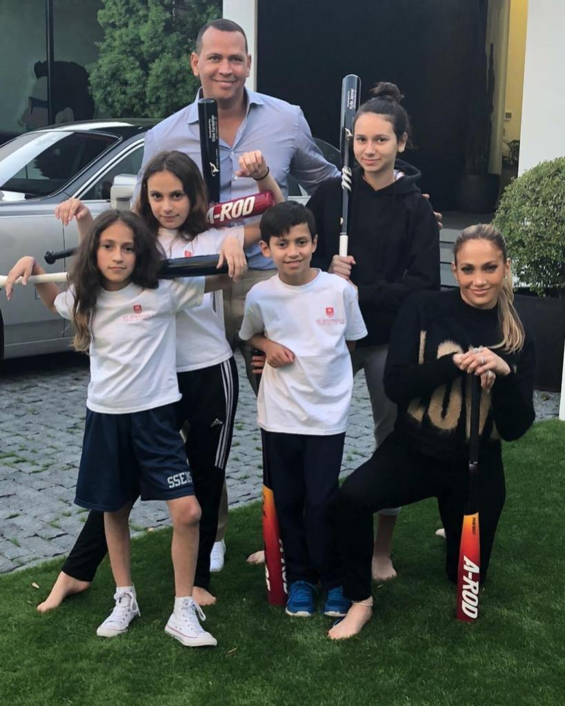Alex Rodriguez And His Two Daughters and Jennifer Lopez And Her Twins Pose With Baseball Bats