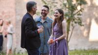 Amanda Knox Speaking With Some People and Sipping a Drink in Italy