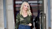 Ashley Martson Walks Out of Building Wearing Camo Long-Sleeve Top and Jeans