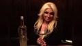 Beth Chapman Holds Martini in Dark Bar
