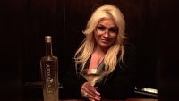 Beth Chapman Holds Martini in Dark Bar