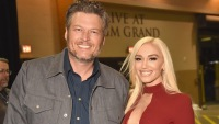 Blake Shelton Wearing a Jacket and Gwen Stefani Wearing a Red Dress