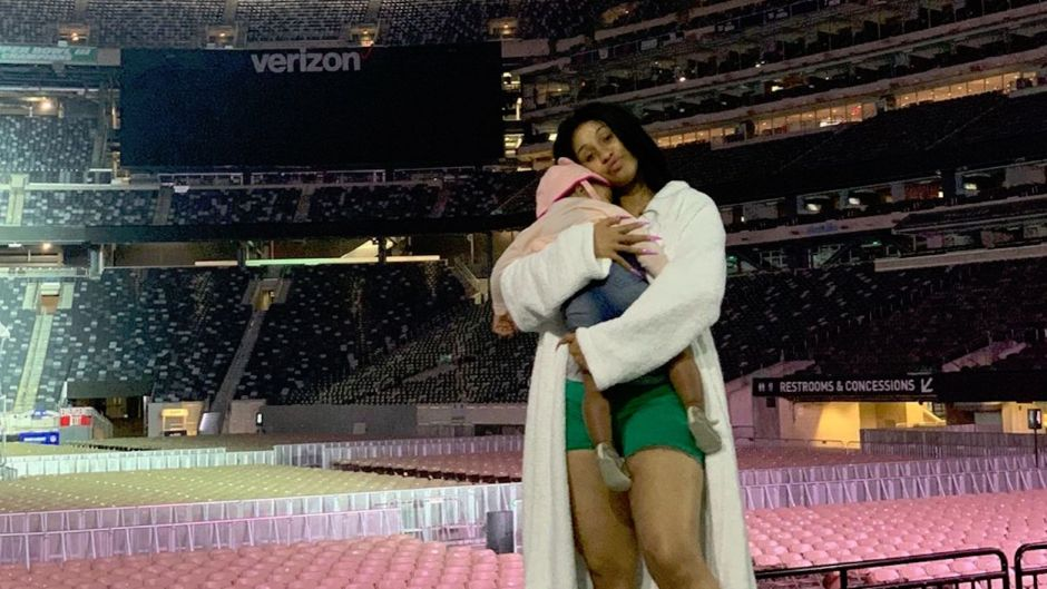 Cardi B on Stage Holding Her Daughter Kulture