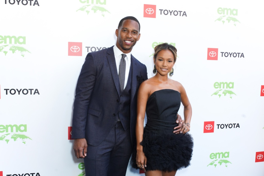 Karrueche Tran With Victor Cruz Both Wearing Black at an Event