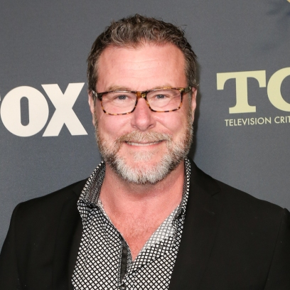 Dean McDermott Wearing Glasses and a Black Jacket at an Event