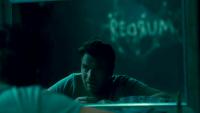 Ewan McGregor in Doctor Sleep Seeing 'Redrum' On The Wall Behind Him Through a Mirror