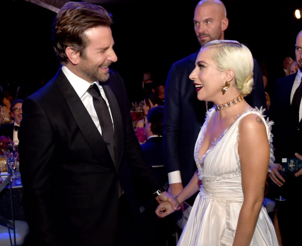 Bradley Cooper Smiling at Lady Gaga in a White Dress