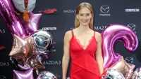 Bar Refaeli Stands Smiling in a Red Silk Dress Surrounded by Balloons Pregnancy
