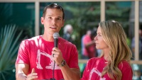Granger Smith Wearing a Red Shirt With His Wife