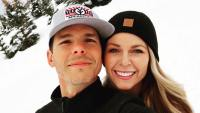 Granger Smith and His Wife Amber Wearing Hats in the Snow