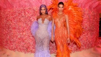 Kylie Jenner Wearing a Purple Dress With Kendall Jenner Wearing an Orange Dress