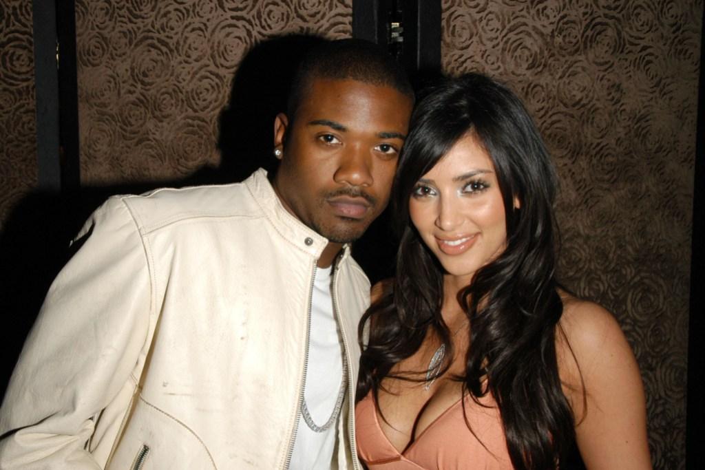 Ray J Wearing a White Jacket With Kim Kardashian Wearing a Pink Dress