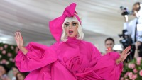 Lady Gaga Wearing a Huge Pink Dress with a Bow on Her Head to the Met Gala