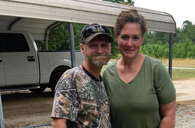 Mike Sugar Bear Thompson Wears Camo Shirt And Smiles With Wife Jennifer Lamb In Olive Green Top
