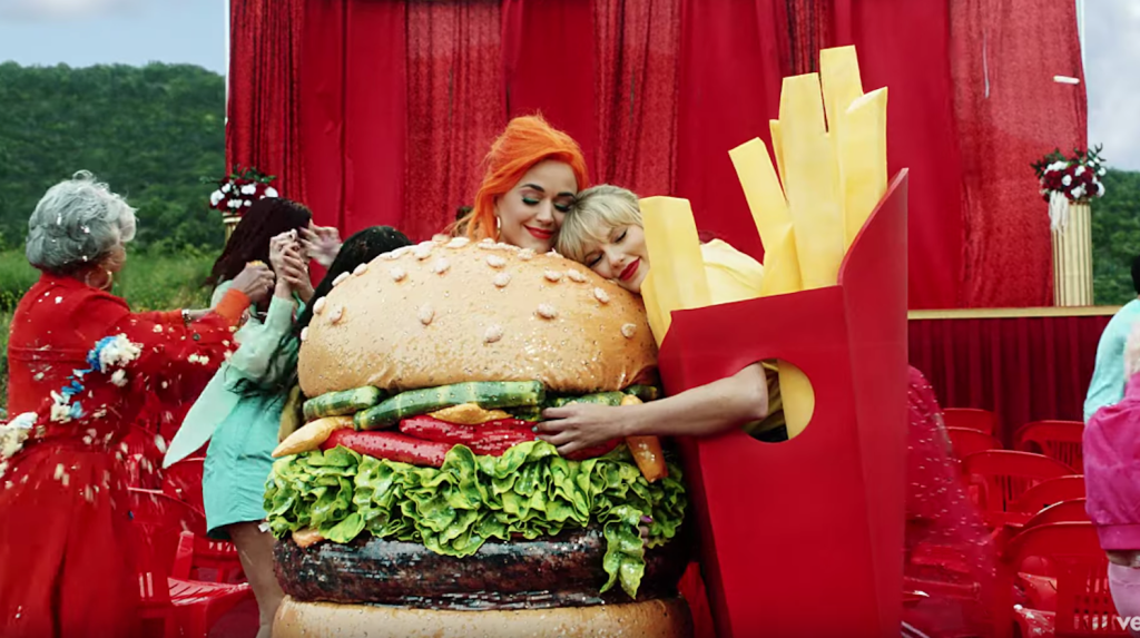 Taylor Swift Wears a French Fry Costume as She Hugs Katy Perry Wearing a Burger Costume During the You Need to Calm Down Music Video