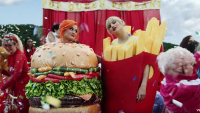 Taylor Swift Stands in a French Fry Costume Next to Katy Perry in a Burger Costume During the You Need to Calm Down Music Video