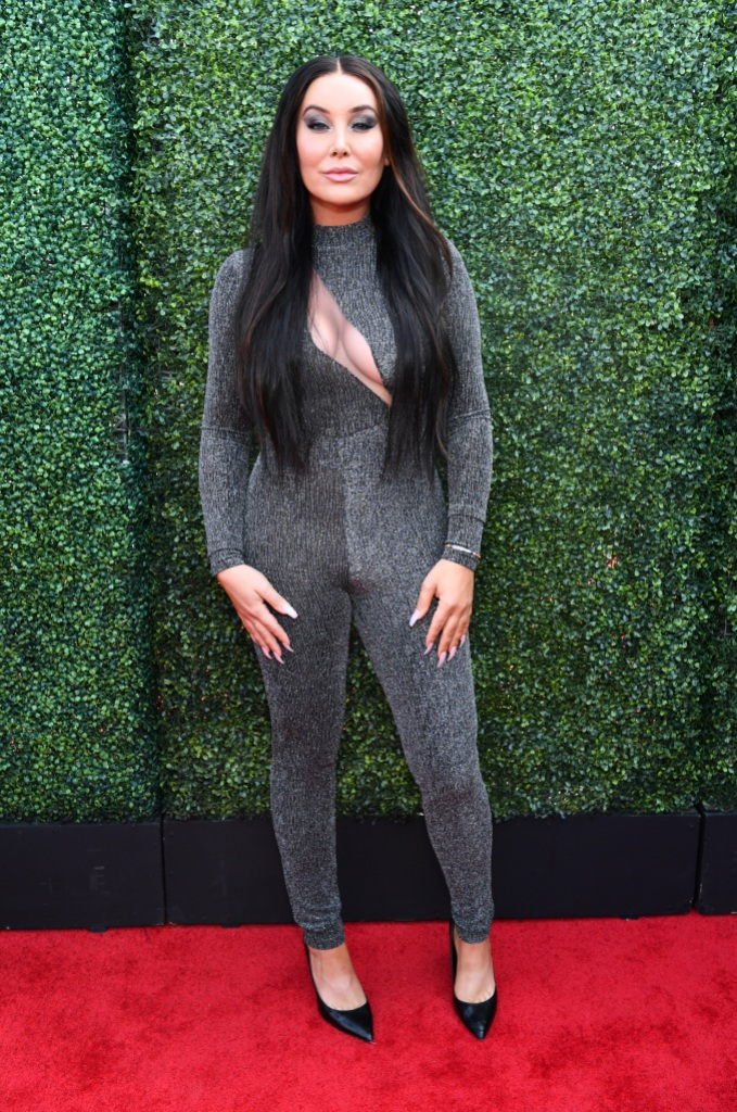 billie lee wore a fitted sparkly gray bodysuit on the 2019 mtv movie and tv awards red carpet