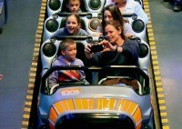 jennifer garner snaps a photo of her son samuel and daughter seraphina on a ride at disneyland