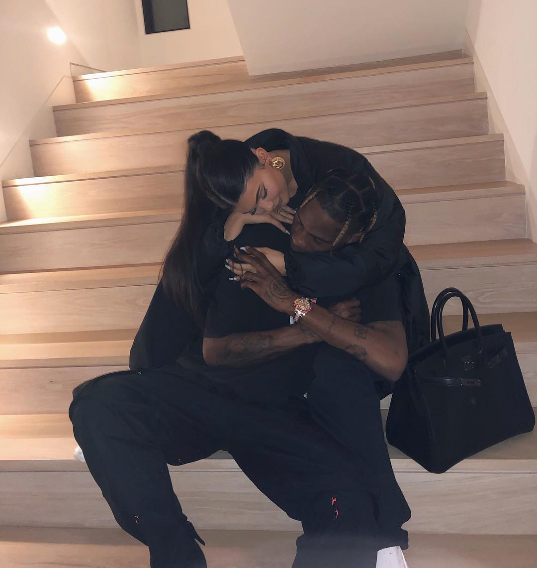 Kylie Jenner and Travis Scott Hugging on the Stairs