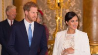 Meghan Markle in White Dress and Coat Smiles with Prince Harry in Black Suit and Blue Tie