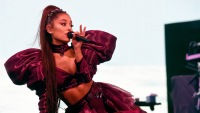Ariana Grande Wearing a Dress With Poufy Sleeves Singing on STage