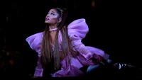 Ariana Grande Wearing a Pink Outfit on Stage