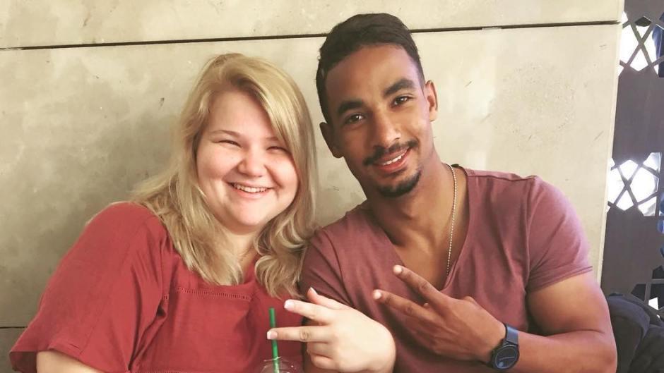 Azan Tefou and Nicole Nafziger Throw Up Peace Signs