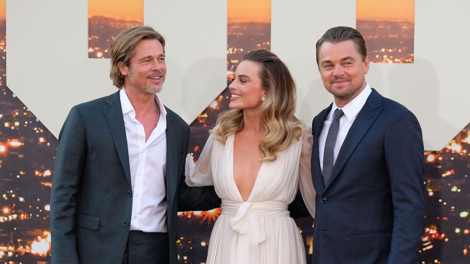 Margot Robbie Wearing a White Dress With Brad Pitt and Leonardo DiCaprio Wearing Suits