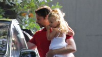 Bradley Cooper Carrying His Daughter Around Wearing a Red Shirt