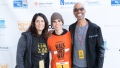 Cameron Boyce Wearing an Orange Shirt With His Family