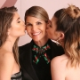 Lori Loughlin Smiling While Her Daughters Bella and Olivia Kiss Her on the Cheek