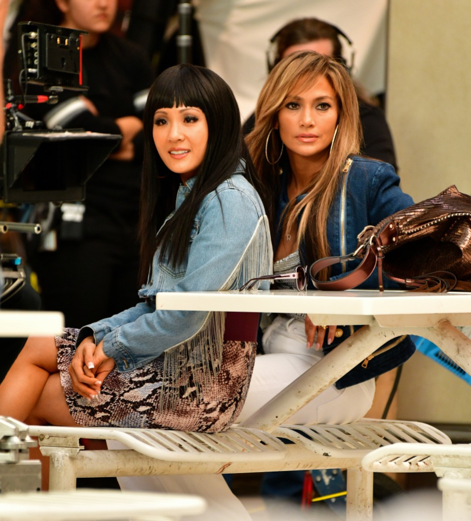 Constance Wu Wearing a Jean Outfit with Jennifer Lopez Sitting Next to Her