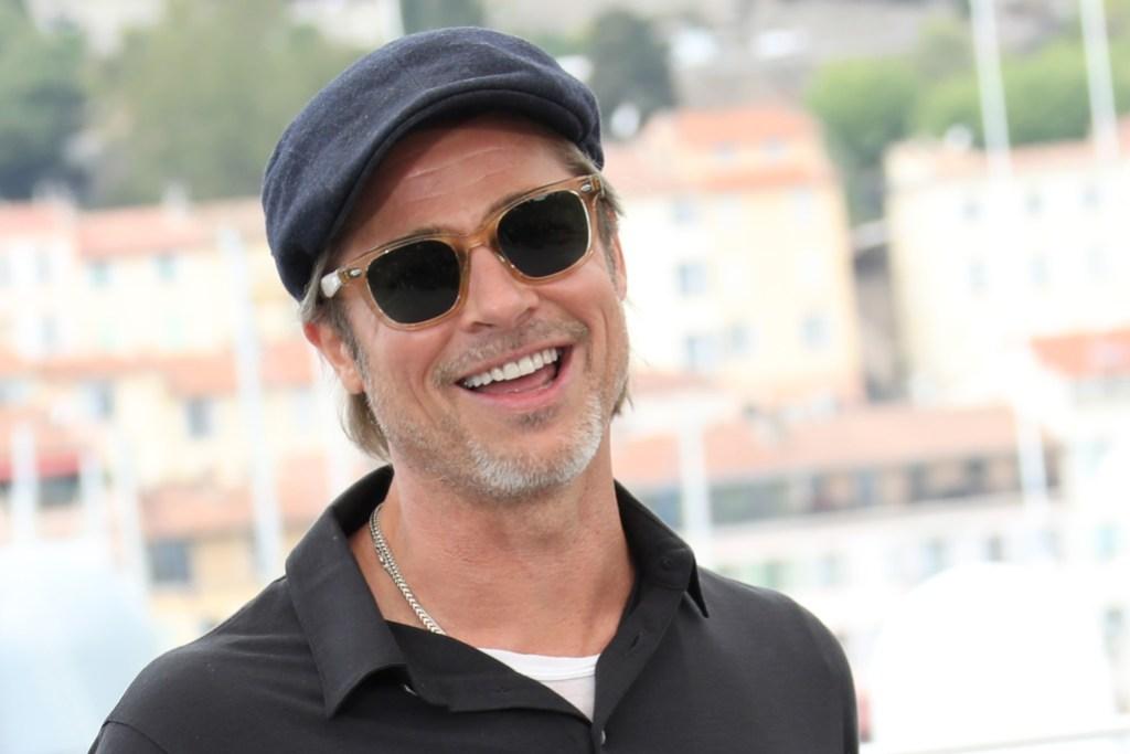 Brad Pitt Wearing Sunglasses and a T-Shirt